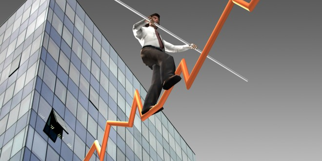 Businessman on a finance graphic aiming for the top